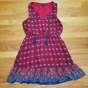Red printed sleeveless dress with tassels